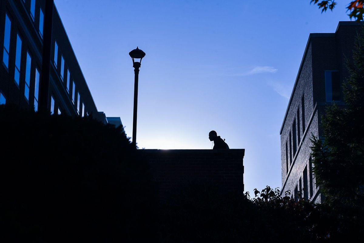 silhouette of man walking up steps